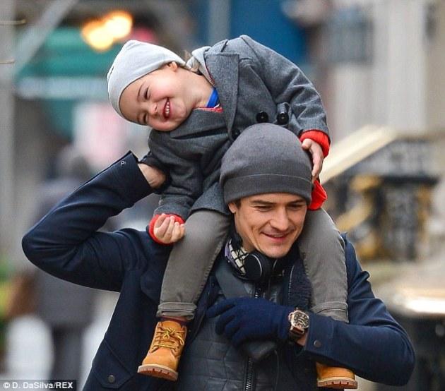 son on mans shoulder